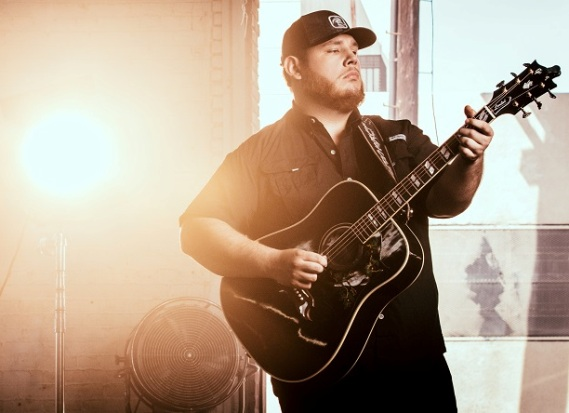 Luke Combs with his Guitar